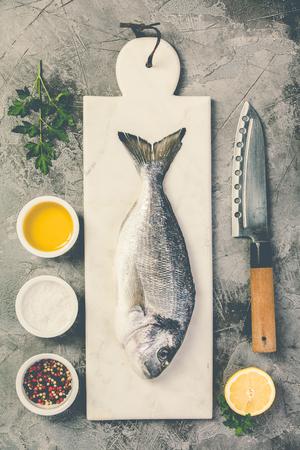 Delicious fresh sea bream fish, flat lay, top view