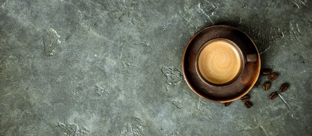 Cup of coffee on rustic background with space for text, flat lay Stock Photo
