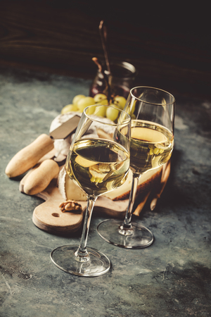 White wine with charcuterie assortment on the stone Stock fotó