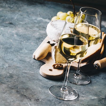 White wine with charcuterie assortment on the stone Stock Photo