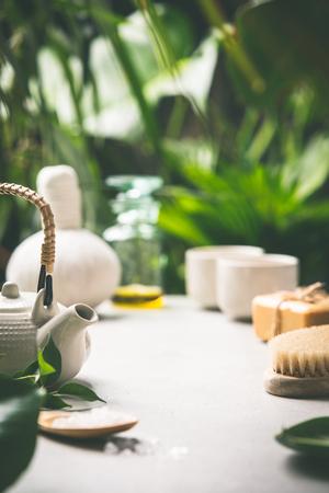 Tea composition on tropical leaves background, close up Banco de Imagens
