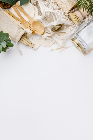 Natural color eco bags, reusable metal and bamboo straws, glass jars, wooden knifes and forks, zero waste cleaning and beauty products, flat lay Standard-Bild - 122014799