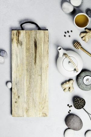 Asian tea set and spa stones on concrete background Standard-Bild - 123182941