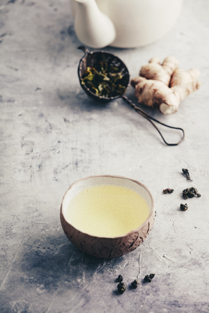Tea composition with old chinese cups of green tea and white teapot Standard-Bild - 123182947