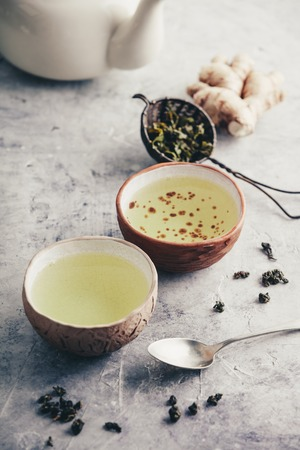 Tea composition with old chinese cups of green tea and white teapot Standard-Bild - 123182950