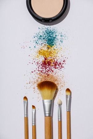 Makeup brushes and cosmetic products on a white background 스톡 콘텐츠