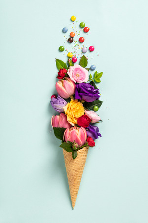 Ice cream cone with flowers and sprinkles Summer minimal concept. Banco de Imagens