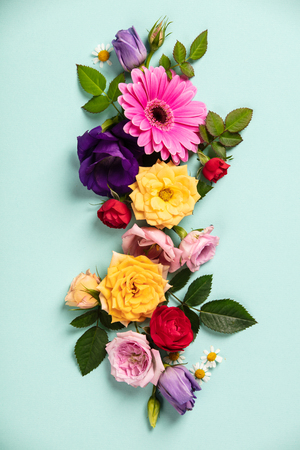 Creative layout made with beautiful flowers on blue background. Flat lay. Spring minimal concept. Flat lay composition for entrepreneurs, bloggers, magazines, websites, social media Standard-Bild - 123837768