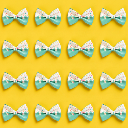 Colorful hair bow pattern on pastel blue background, flat lay, top view Standard-Bild - 123837821