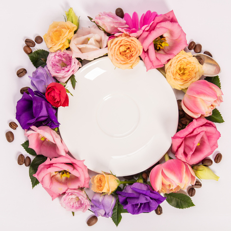 Still life composition with plate and flowers