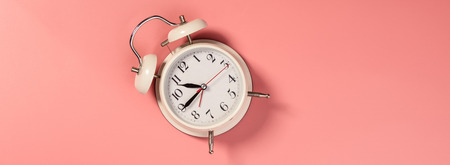 White alarm clock on pink background - pattern