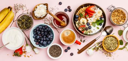 Healthy breakfast set with coffee and granola Standard-Bild - 124680773
