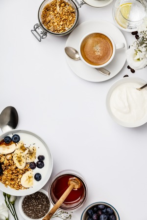 Healthy breakfast set on white background, top view, copy space Stockfoto