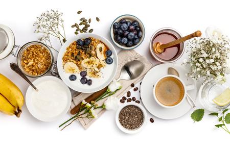 Healthy breakfast set on white background, top view, copy space Standard-Bild - 124680777