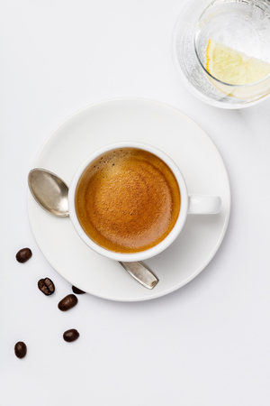 Cup of coffee on white background, top view Standard-Bild - 124680779