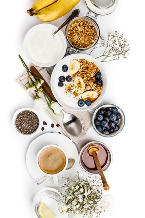 Healthy breakfast set on white background, top view, copy space Standard-Bild - 124680780