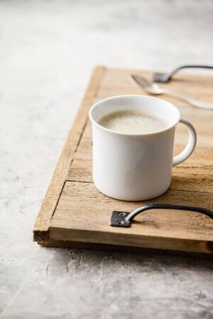 A cup of coffee on light grey background Standard-Bild - 124959314