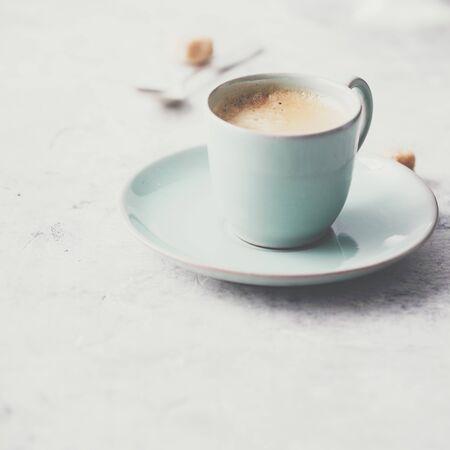 A cup of coffee on light grey background, coffee break concept Archivio Fotografico - 124959316