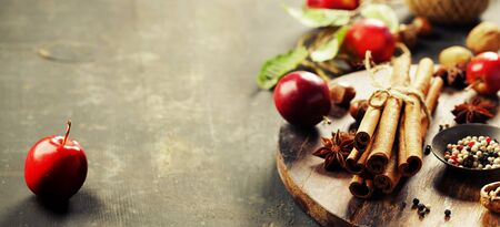 Spices and apples on rustic table Stok Fotoğraf