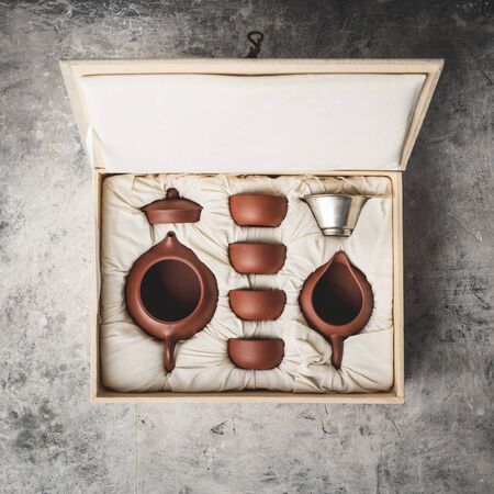 Tea set in the box on concrete background, flat lay