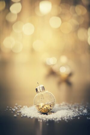 Christmas decoration on abstract gold background, close up