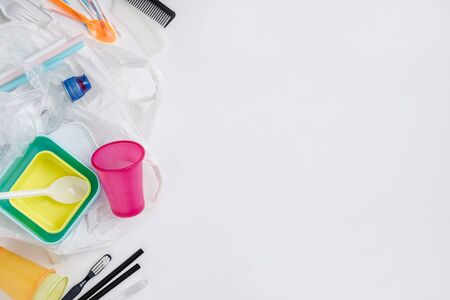 Plastic items on white background, flat lay