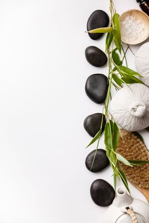 SPA background with massage compress balls, stones, sea salt, brush and teapot Stock Photo