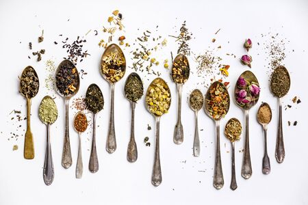 Assortment of dry tea in vintage spoons