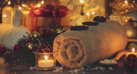 Spa composition with Christmas decoration. Holiday SPA treatment. Holiday and relaxation concept