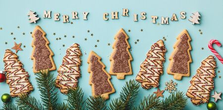 Merry Christmas written with wooden letters, cookies and Christmas decorations Stok Fotoğraf