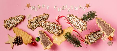 Christmas gingerbread cookies in the shape of a Christmas tree falling or flying in motion