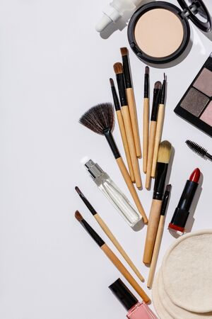 Makeup brushes and cosmetic products on a white background Stok Fotoğraf