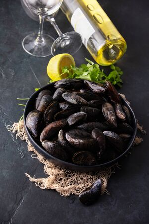 Bowl with fresh raw mussels on dark background Stok Fotoğraf