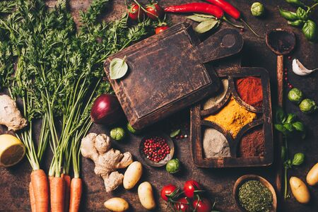 Fresh delicious ingredients for healthy cooking on rustic background