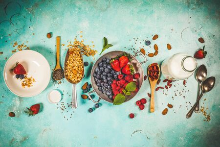 Healthy Breakfast set with granola, superfoods, almond milk and berries Stok Fotoğraf
