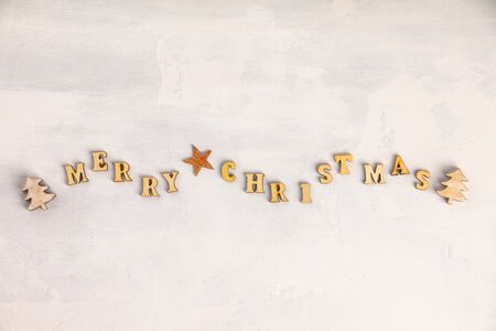 Merry Christmas written with wooden letters, flat lay
