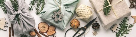 Fabric wrapped gifts and wooden Christmas decorations Zdjęcie Seryjne - 134351592