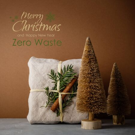 Fabric wrapped gifts, Zero waste beauty body care and house cleaning items and wooden Christmas decorations with