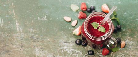 Berry smoothie on rustic wooden background - Detox, dieting, clean eating, vegetarian, vegan, fitness, healthy lifestyle concept