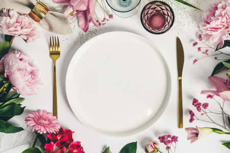Elegant table setting with floral decor, flat lay