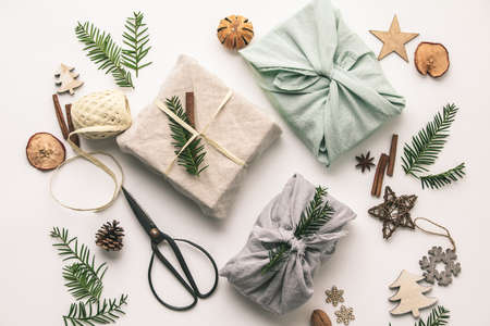 Fabric wrapped gifts and wooden Christmas decorations Stock Photo