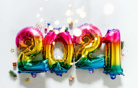 Rainbow colored Foil balloons in the form of numbers 2021. New year celebration Foto de archivo