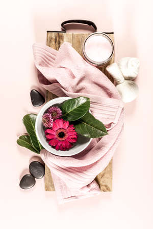 Spa setting on pink background. Flat lay