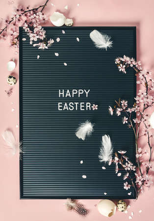 Easter background with letter board and spring flowers