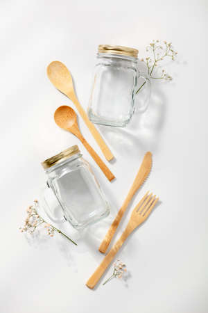 Zero waste, eco friendly concept. Glass jars and bamboo cutlery on white background Reklamní fotografie
