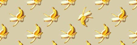 Colorful fruit pattern of fresh yellow bananas on yellow background