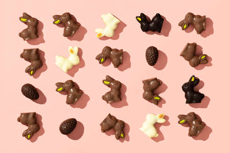 Chocolate Easter Eggs and Bunnies on pink background pattern