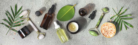 Natural SPA cosmetic products background, Composition with bottles of essential oils, sea salt and massage rollers, banner Imagens
