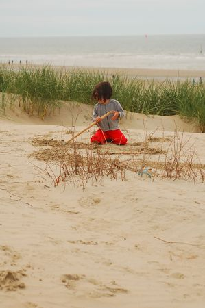 Small girl playing in dunes