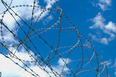 Barbed wire on fence photo